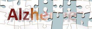 Bild zeigt das Wort Alzheimer als ein Puzzle, von dem Teile fehlen